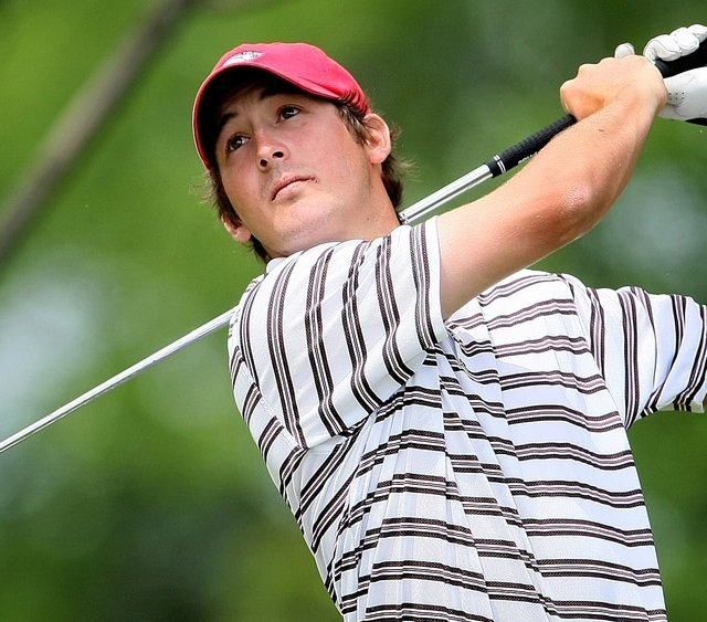 Arkansas&#39; Andrew Landry hits an approach shot at the NCAA Championship.