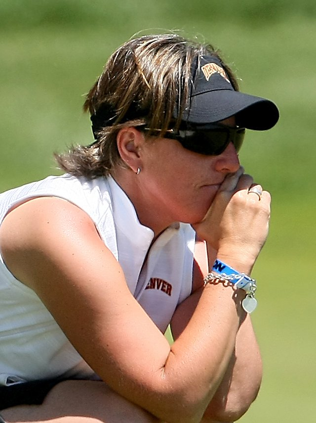 Univeristy of Denver head coach Sammie Chergo watches her players at No. 9 during the 2009 NCAA Women&#39;s Golf Championships at Caves Valley Golf Club in Owings Mills, Md.