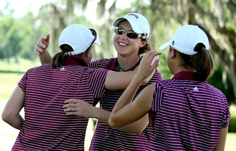 Katie Kempter of University of Denver celebrates with her teammates at the 2009 NCAA Women's East Regional at Mark Bostick Golf Course at University of Florida.