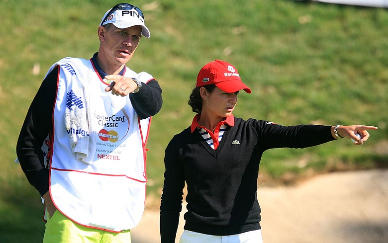 Lorena Ochoa of Mexico talks with her caddie Dave Brooker on the fourth green during the first round of the MasterCard Classic.