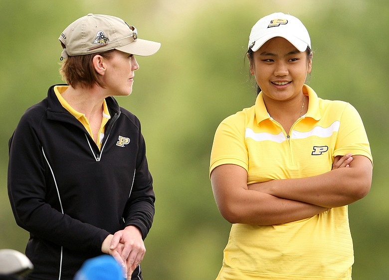 Purdue's Junthima Gulyanamitta talks with assistant women's golf coach JoJo Robertson during the final round of the UCF Challenge at Red Tail Golf Club.