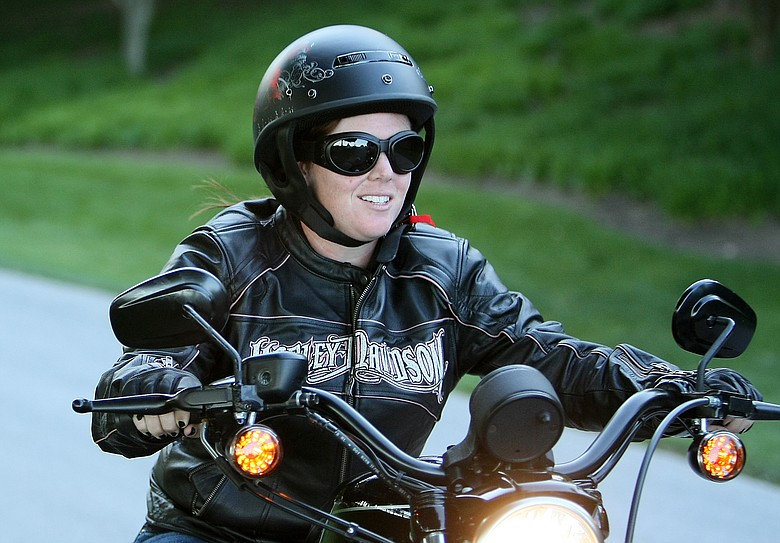 UCF golfer Stephanie Connelly rides her Harley-Davidson during the 2009 NCAA Women's Golf Championships at Caves Valley Golf Club in Owings Mills, Md.