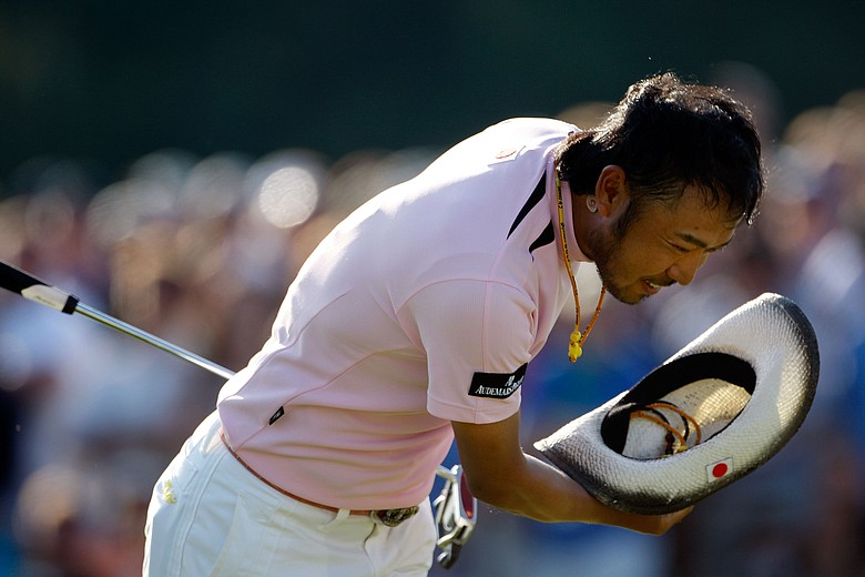 Shingo Katayama of Japan walks off the 18th green after a four-under par 68 during the final round of the 2009 Masters.