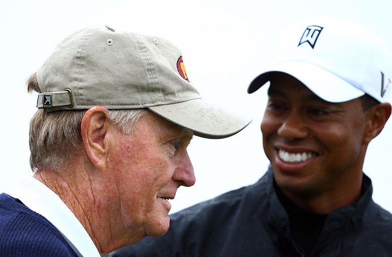 Jack Nicklaus and Tiger Woods wait on the tenth tee during a skins game prior to the start of the 2009 Memorial Tournament.