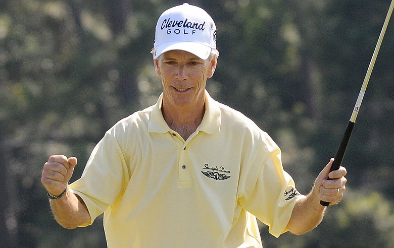 Larry Mize of the US celebrates after finishing the first round of the US Masters at the Augusta National Golf Club on April 9, 2009. Mize finished the round at five under par.