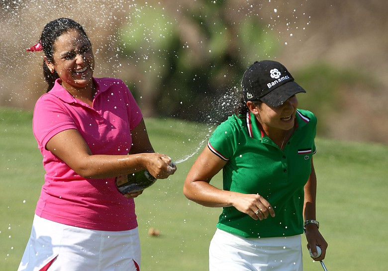Lorena Ochoa of Mexico is sprayed by chapagne by top amatuer player in the tournament Daniela Ortiz after Ochoa's 25-under par victory.