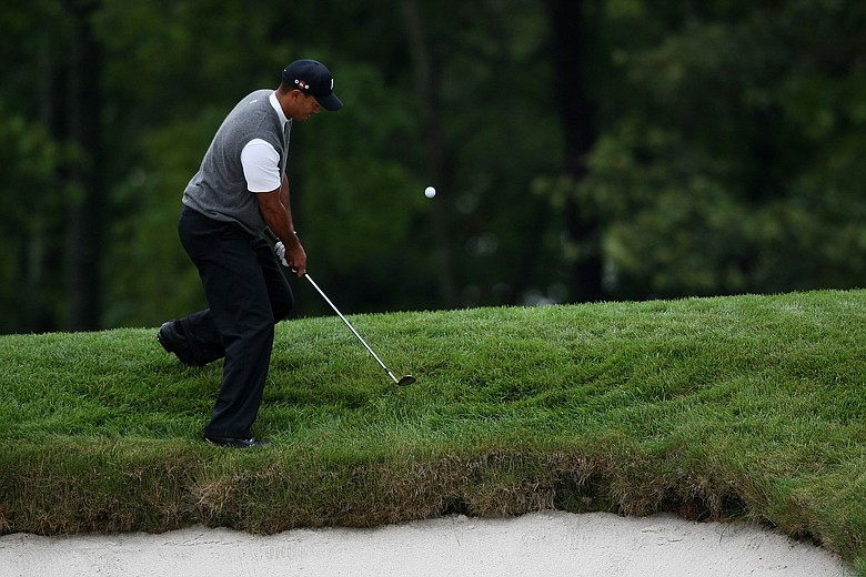 Tiger Woods hits a shot on the 15th hole during the continuation of the first round of the 109th U.S. Open.