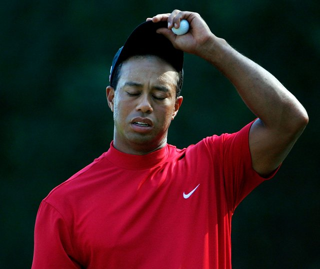 Tiger Woods reacts on the green of the 12th hole during the final round of The Players Championship.