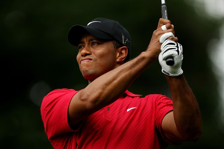 Tiger Woods watches his tee shot on the eighth hole during the continuation of the third round of the 109th U.S. Open.