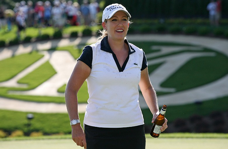 Cristie Kerr walks off the 18th green with a Michelob Ultra after winning the the Michelob Ultra Open at Kingsmill Resort.