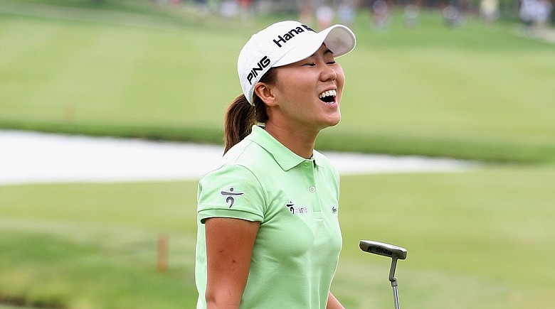 In-Kyung Kim of South Korea reacts after winning the 2009 LPGA State Farm Classic.