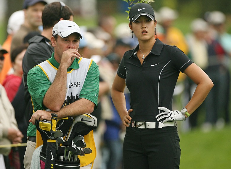 Michelle Wie and her caddie Gary Matthews discuss a shot.