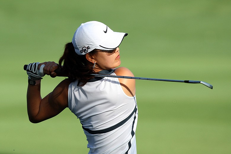 Michelle Wie hits her second shot at the 12th hole during the first round of the 2009 Kraft Nabisco Championship.