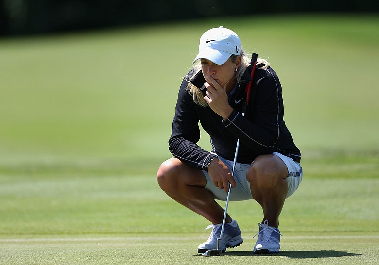 Suzann Pettersen of Norway reviews the eighth hole green during the second round of the LPGA State Farm Classic.