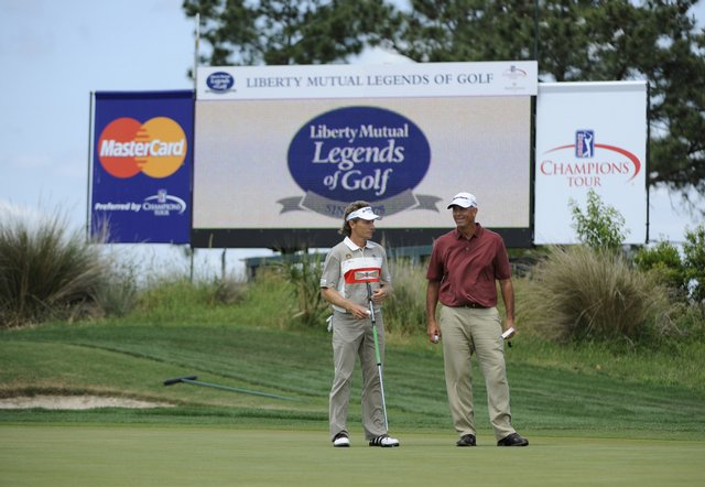 Tom Lehman and Bernhard Langer wait to putt on the 17th green during the final round of the Legends Division at the Liberty Mutual Legends of Golf.