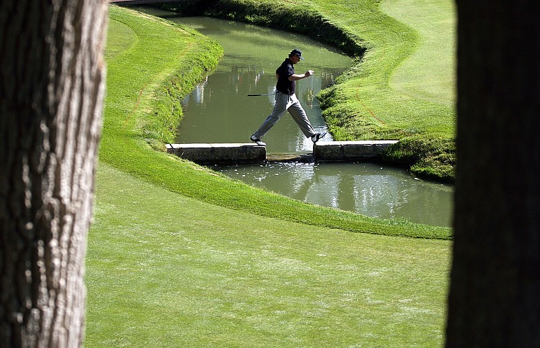 Ernie Els of South Africa crosses the creek on the 14th hole during the second round of the Memorial Tournament.