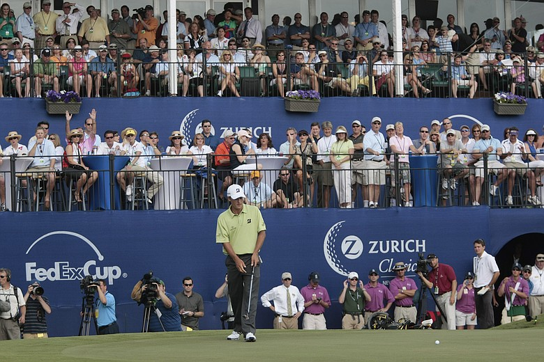 Charles Howell III watches his birdie putt slide by the hole on the 18th green during the final round of the Zurich Classic.