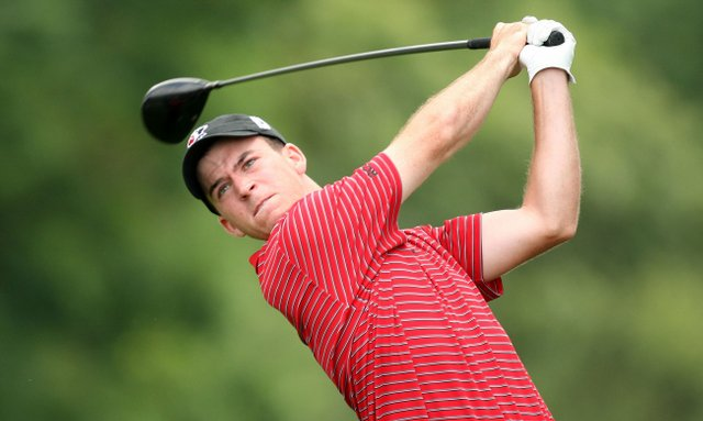 Amateur Nick Taylor plays his tee shot on the ninth hole during the continuation of the third round of the 109th U.S. Open.