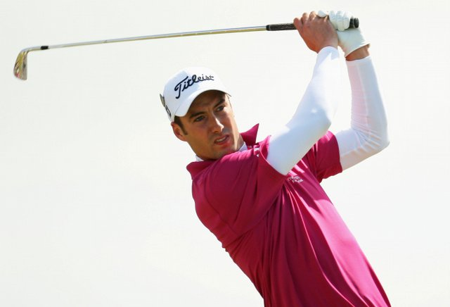 Ross Fisher of England tees off on the 6th hole during the final round of the 138th Open Championship.