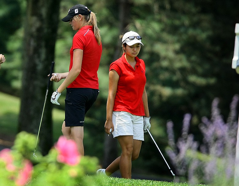 Kimberly Kim, right, and Maude-Aimee Leblanc, left, at no. 14 during Wednesday match play of the 109th U. S. Women's Amateur Championship.