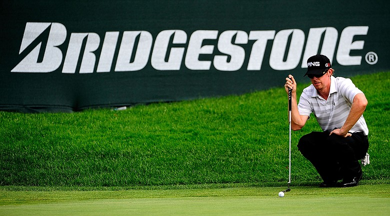 Hunter Mahan looks over a shot on the 17th hole during the final round of the WGC-Bridgestone Invitational on the South Course at Firestone Country Club in Akron, Ohio.