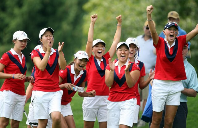 Members of the victorious USA team celebrate while watching the end of the late matches on the final day of the 2009 Junior Solheim Cup Matches, at the Aurora (Ill.) Country Club.