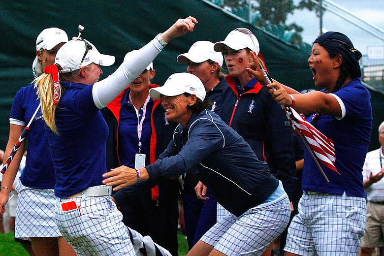 Morgan Pressel is greeted by Juli Inkster, Paula Creamer and Christina Kim and other members of the of the U.S. Team on the 18th green during the Saturday afternoon foursomes matches at the Solheim Cup.