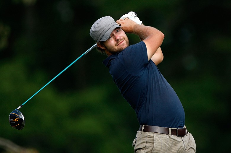 Ryan Moore wins his first PGA Tour title at the Wyndham Championship.