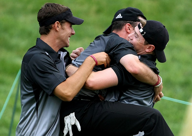 Texas A&M's Matt VanZandt jumps into the arms of teammate Bronson Burgoon after he closed out his match against Michigan's Bill Rankin during the semifinals of match play at the 2009 NCAA Golf Championships at Inverness Club in Toledo, Ohio. At left is Andrea Paven.