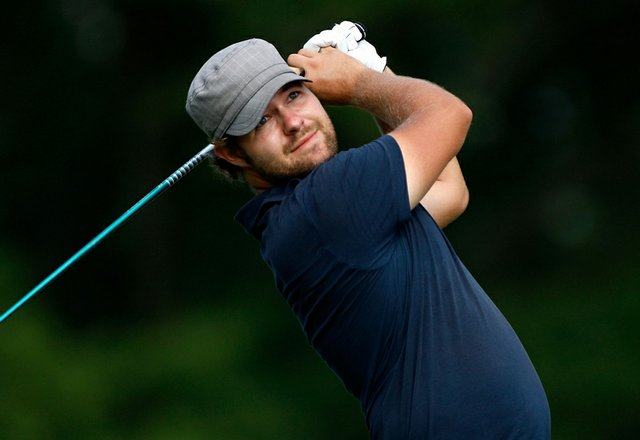 Ryan Moore watches his tee shot on the 18th hole during the final round of the Wyndham Championship at Sedgefield Country Club on Aug. 23, 2009 in Greensboro, N.C.