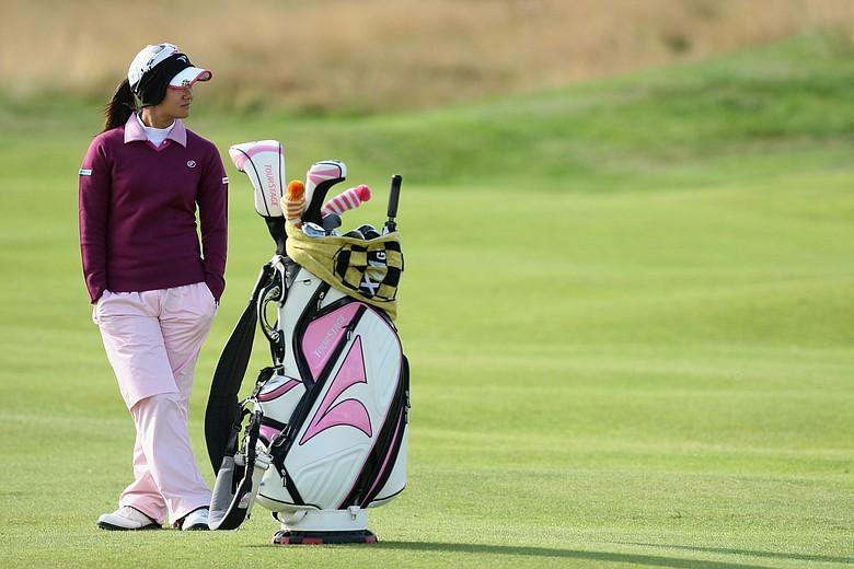Ai Miyazato of Japan waits on the fourth hole during the first round of the 2009 Ricoh Women's British Open Championship.