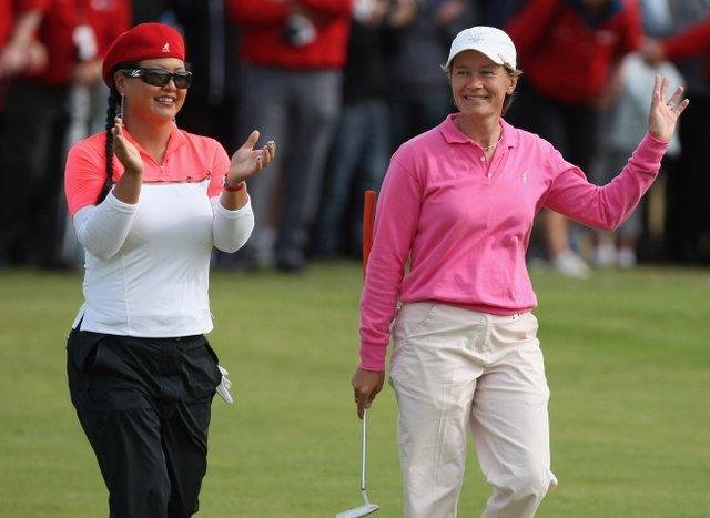 Christina Kim applauds Catriona Matthew at the Ricoh Women's British Open.