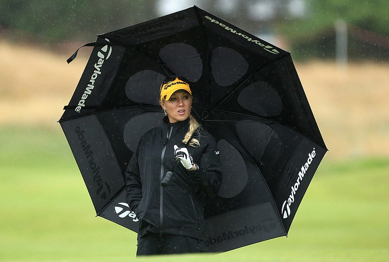 Natalie Gulbis of USA shelters under an umbrella during the Pro-Am prior to the 2009 Ricoh Women's British Open Championship held at Royal Lytham St Annes Golf Club.