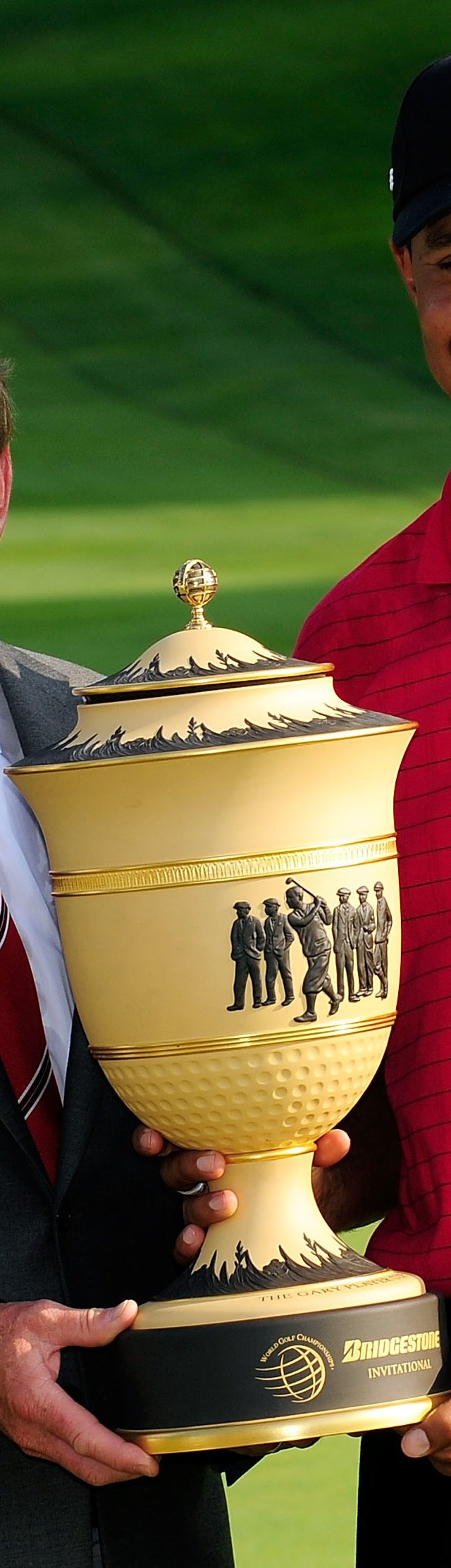 Tiger Woods and Tim Finchem, Commissioner of the PGA Tour, holds the Gary Player trophy following the final round of the WGC-Bridgestone Invitational on the South Course at Firestone Country Club.