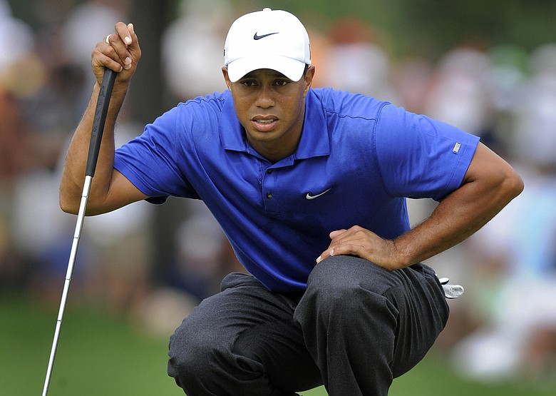 Tiger Woods looks at a putt during the third round of the PGA Championship.