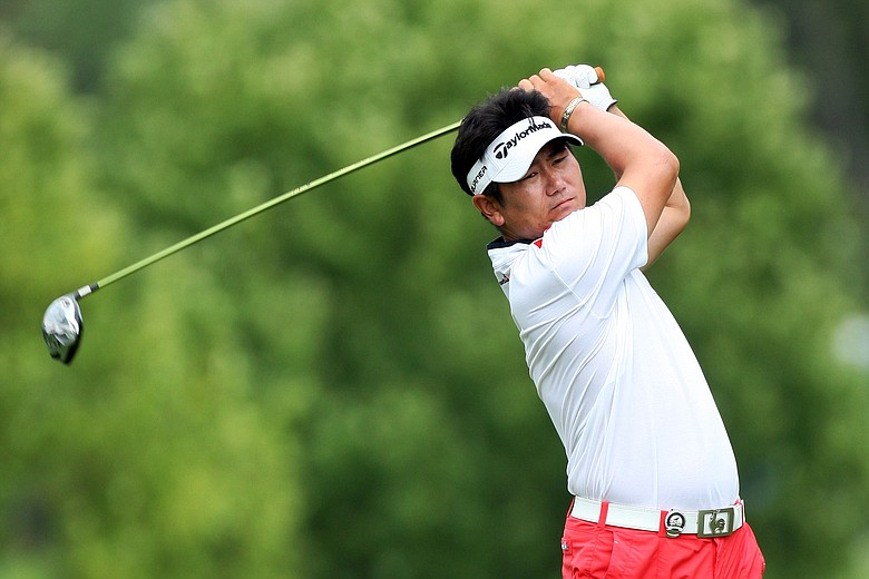 Y.E. Yang hits his tee shot on the 12th hole during the third round of the PGA Championship.