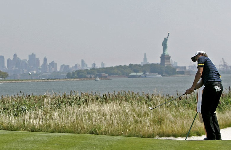 Adam Scott chips on the 14th green at Liberty National Golf Club Aug. 26.
