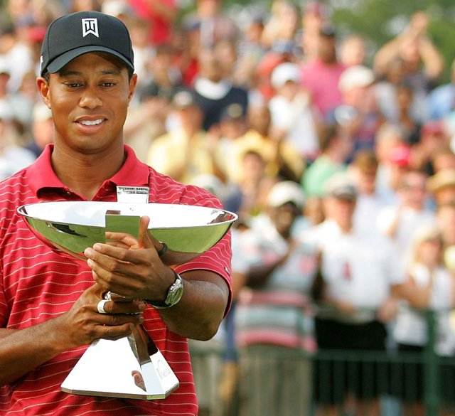 Tiger Woods holds the FedEx Cup trophy after winning the Tour Championship in 2007.