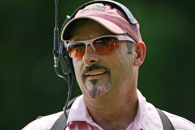 CBS Sports golf analyst David Feherty wears a pink outfit in support of Amy Mickelson and breast cancer research during the third round of the Crowne Plaza Invitational at Colonial Country Club.