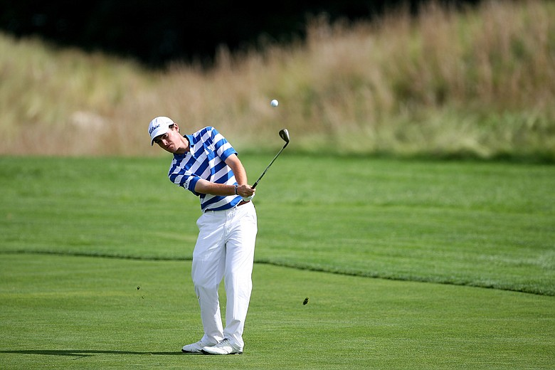 Drew Weaver hits his second shot during the continuation of the second round of the U.S. Open on the Black Course at Bethpage State Park.
