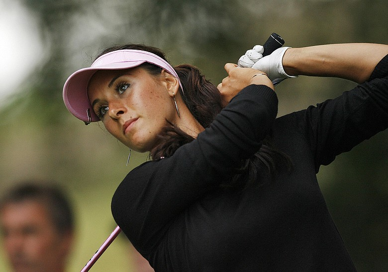 Russian golfer Maria Verchenova watches her drive from the 14th tee during the first round of the 2008 Ricoh Women's British Open Championship.