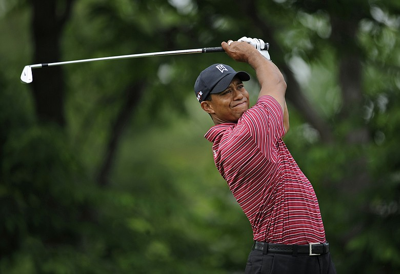 Tiger Woods tees off on the 14th hole during the final round of the Memorial Tournament.