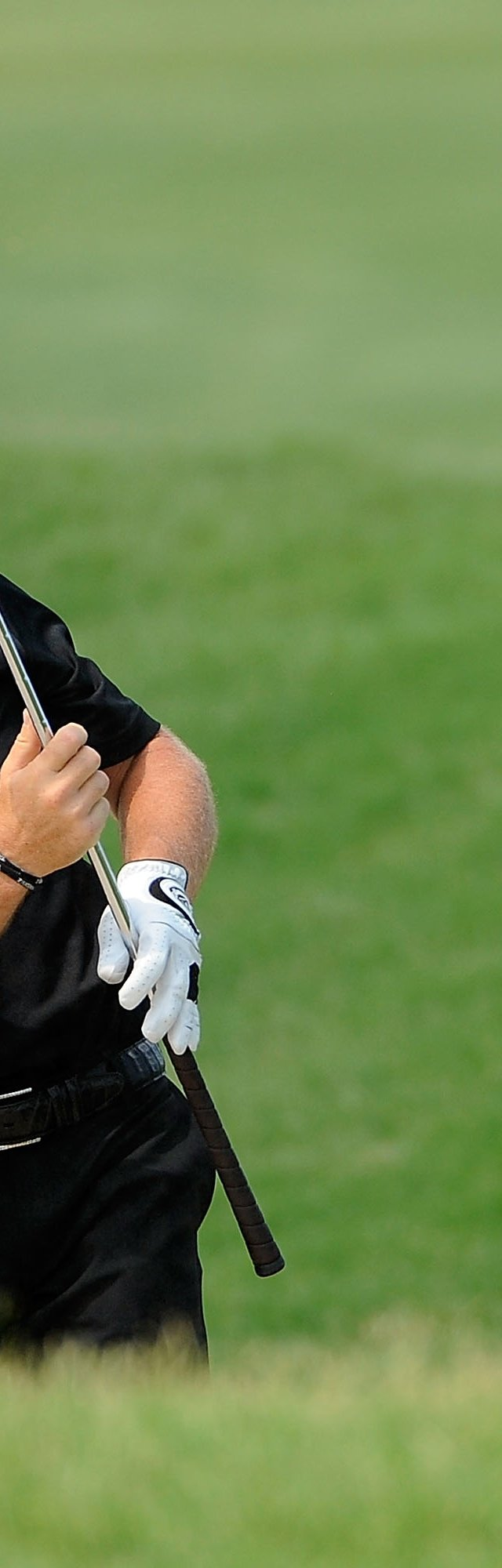 Alex Cejka of Germany reacts to a shot on the third hole during the final round of THE PLAYERS Championship.