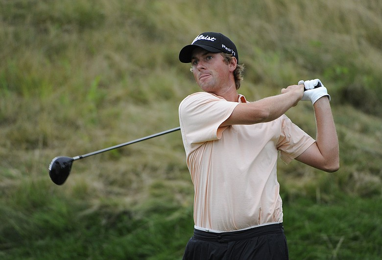 Webb Simpson tees off on No. 8 during the Round 2 of The Barclays at Liberty National Golf Club in Jersey City, N.J.