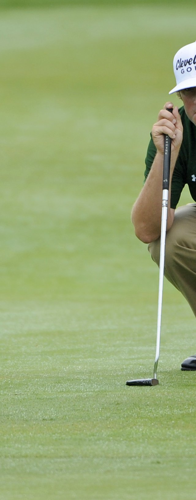 Steve Marino lines up a putt on the first green during the third round of The Barclays at Liberty National.