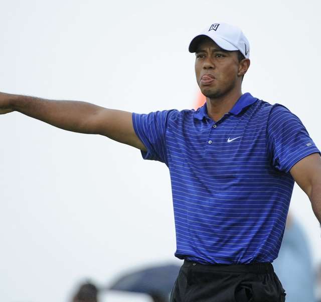 Tiger Woods hits an errant drive during the third round of The Barclays.