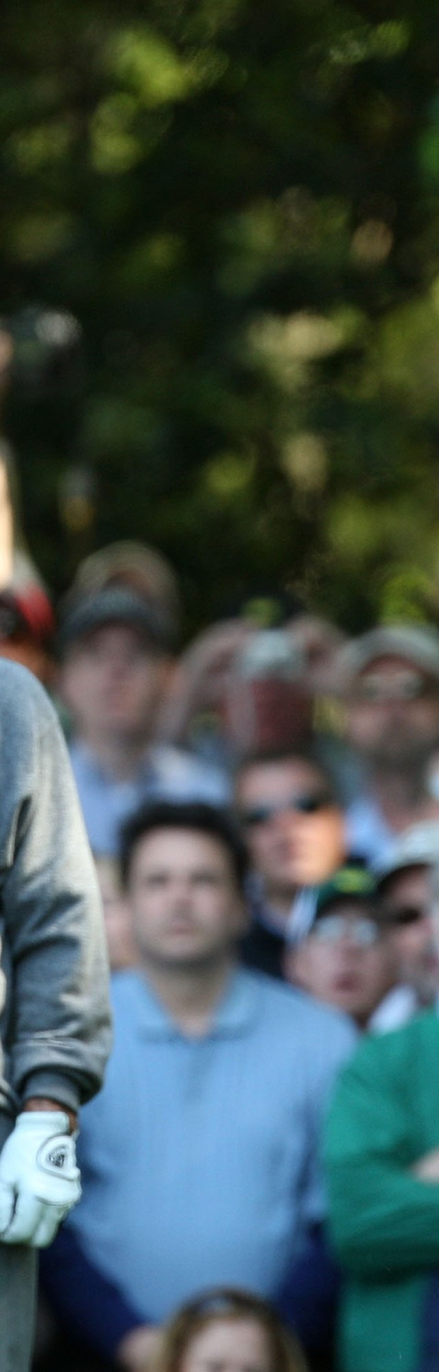 Jack Nicklaus hits a shot while Arnold Palmer looks on during the Par 3 Contest prior to the 2009 Masters.