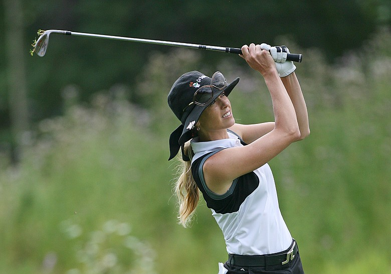Anna Rawson of Australia hits her third shot on the ninth hole during the first round of the Canadian Women's Open at Priddis Greens Golf & Country Club on September 3, 2009 in Calgary, Alberta, Canada.