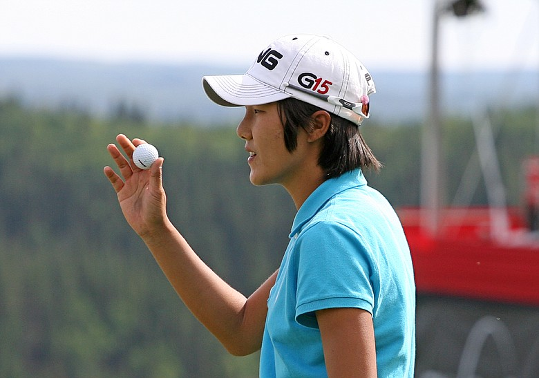 Song-Hee Kim of South Korea waves to the crowd on the 18th green during the second round of the Canadian Women's Open at Priddis Greens Golf & Country Club on September 4, 2009 in Calgary, Alberta, Canada.