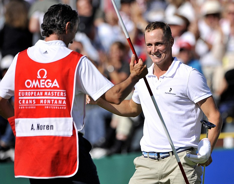 Alexander Noren celebrates with his caddie after winning the European Masters.